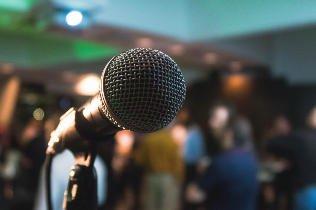 microphone in front of a blurred crowd