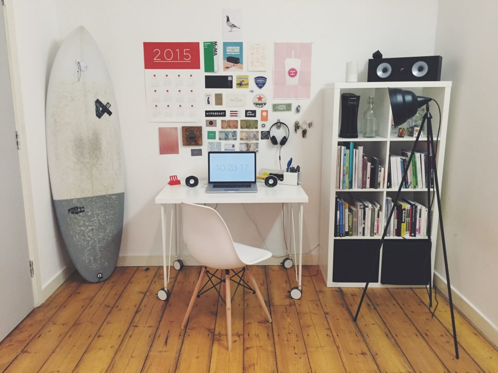 office set up with a lamp and surfboard