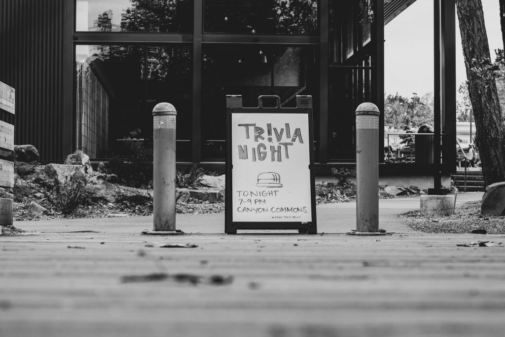 sign that says trivia night