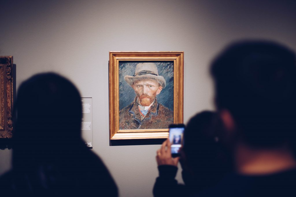 People passing by Vincent van Gogh's self portrait and snapping a photo. More info at the Rijksmuseum's website: https://www.rijksmuseum.nl/en/collection/SK-A-3262